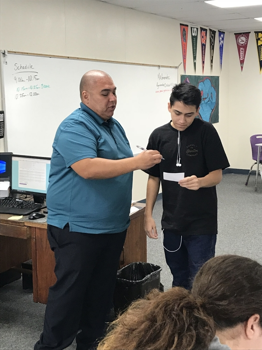 Mr. Gonzalez assisting a student as they continue making progress.