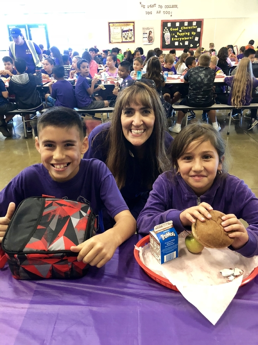 Ms. Robles eating lunch with some of our Citizen of the Month Students