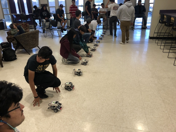 Robotics students working on a challenge