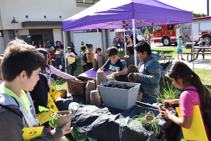 Students potting plants