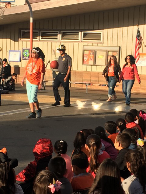 Teachers performing an anti-bullying skit.