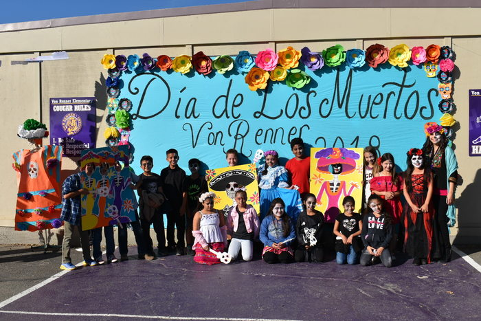 students at the Dia de los Muertos photo wall