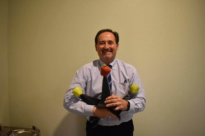 Principal Cope with all his apples