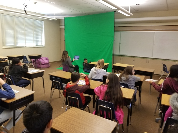 Mrs. Perez' class using a green screen.