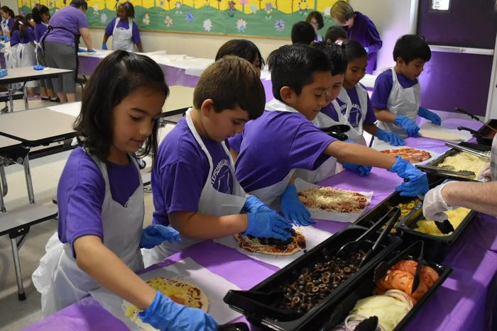 Students adding toppings