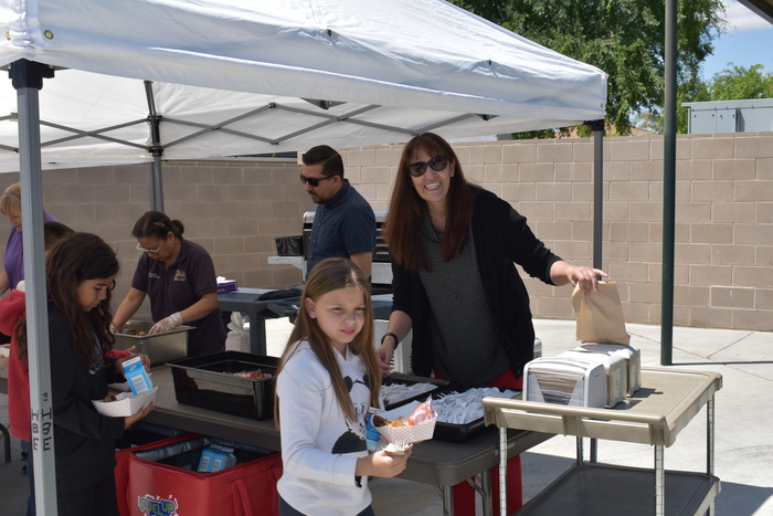 Principal Robles at the BBQ