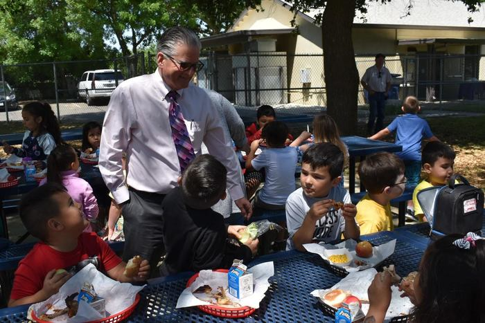 Superintendent Fillpot with students at BBQ