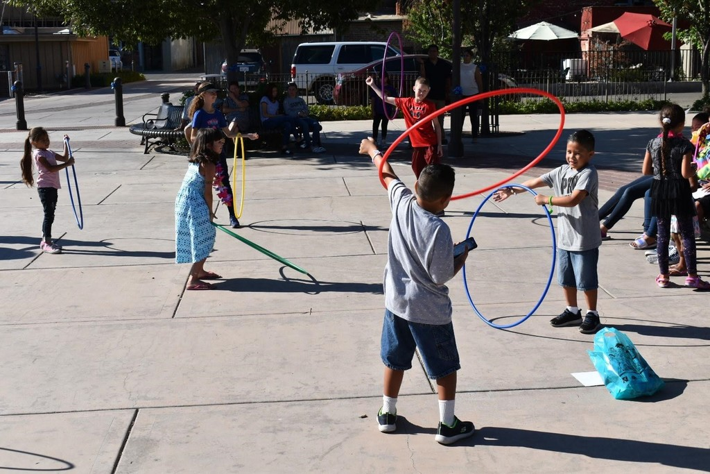 Students playing Hula Hoop games at the event