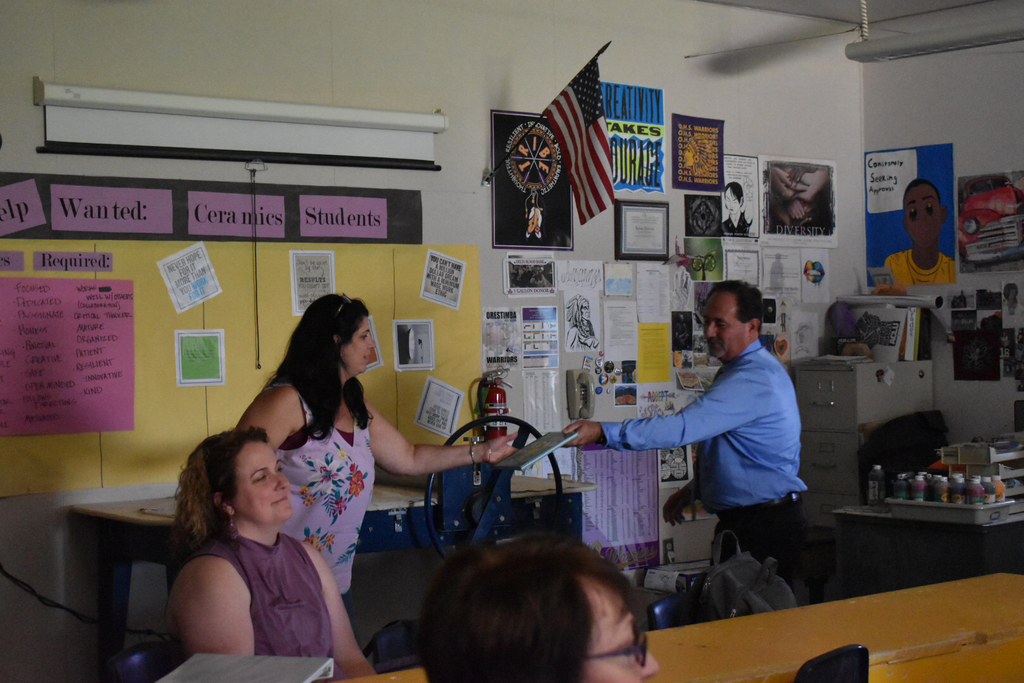 Teacher winning a prize