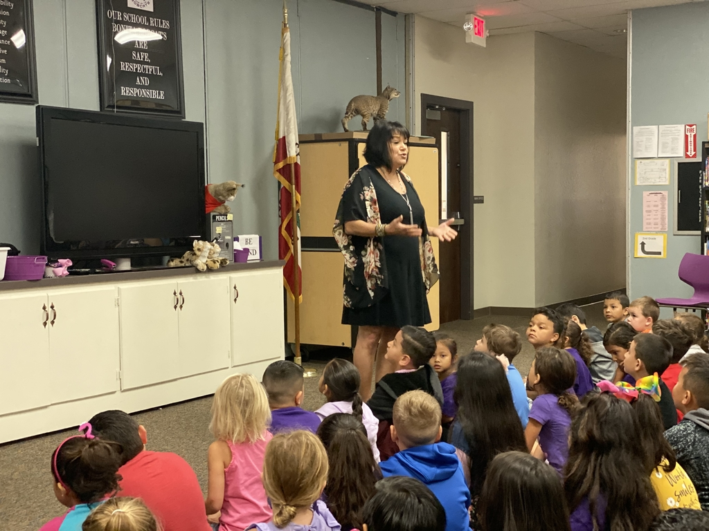 Image of Mrs. Bettencourt speaking to students.