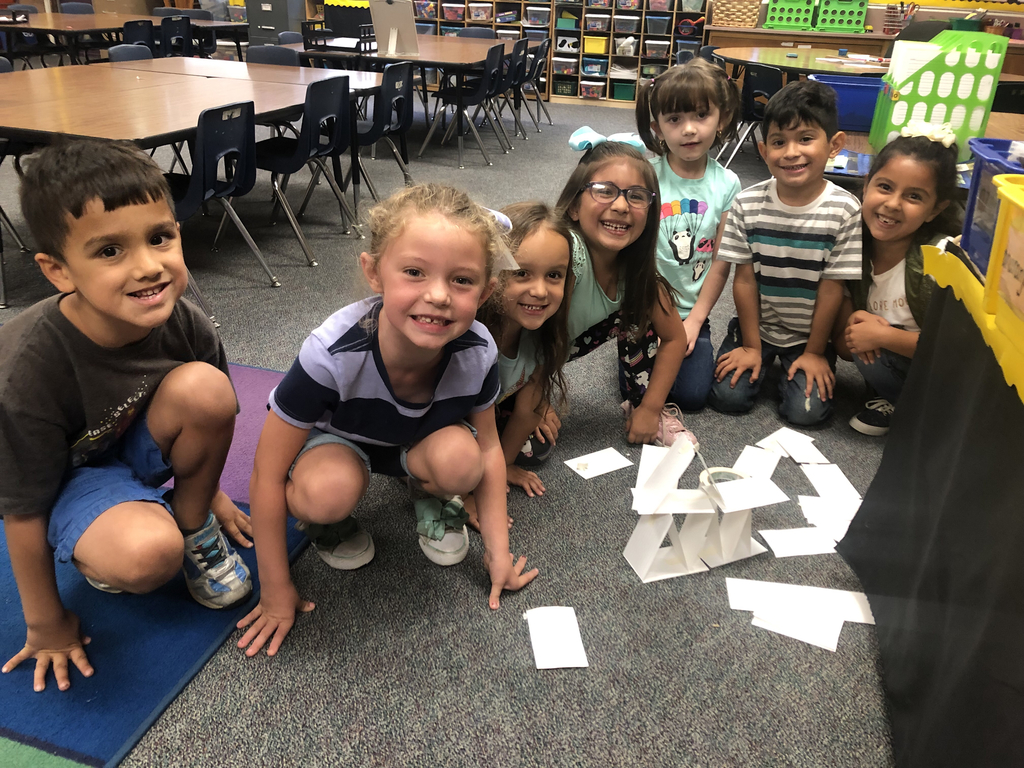 "Mrs. Manriquez's Students had to create a ""beanstalk"" with just cards and tape. So they had to collaborate and come up with a plan. This group was doing so successfully!"