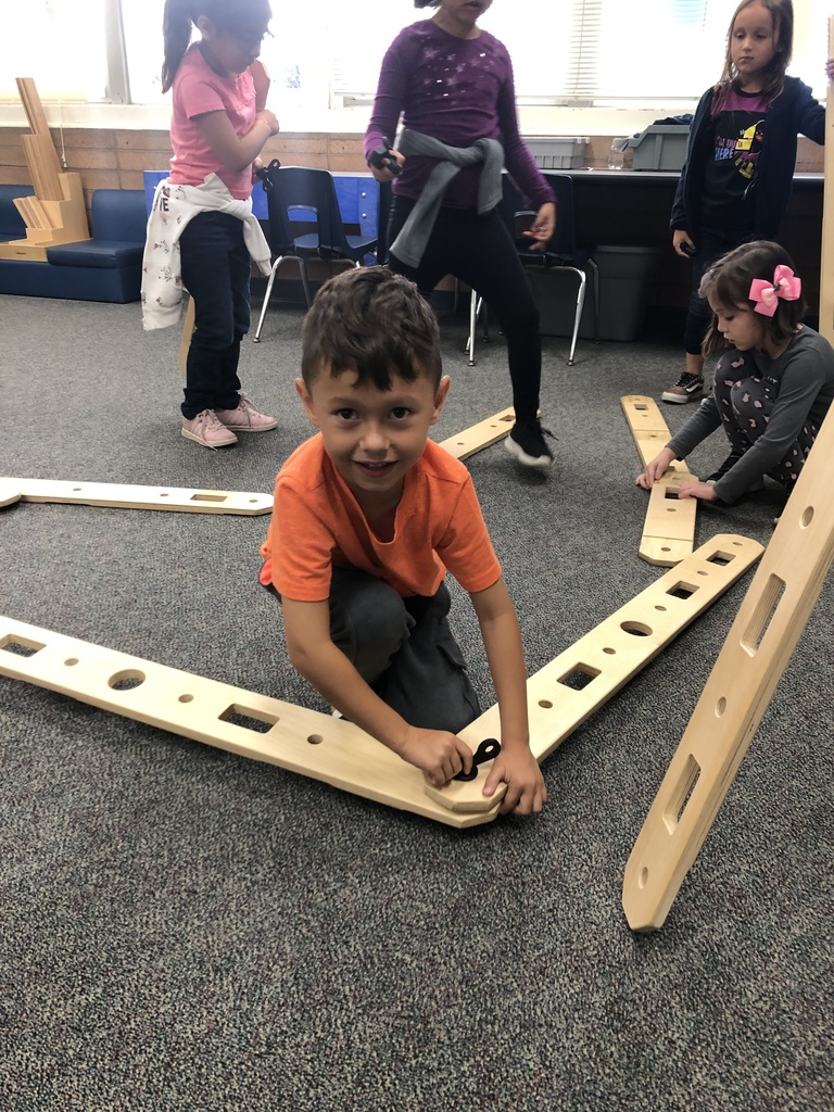 Mrs. Manriquez's class building ramps to discover motion (rolling & sliding) in STEAM lab.