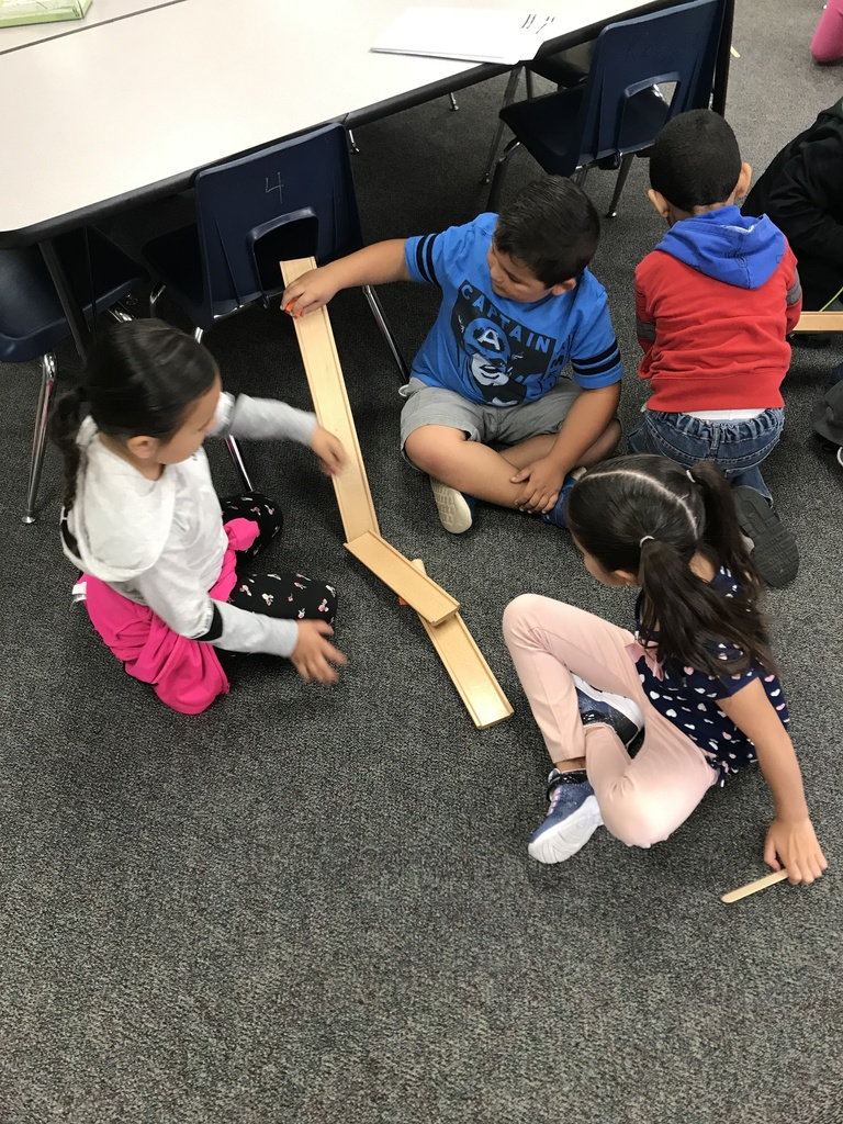 Mrs. Mendoza's class learning about motion by building ramps in STEAM Lab.