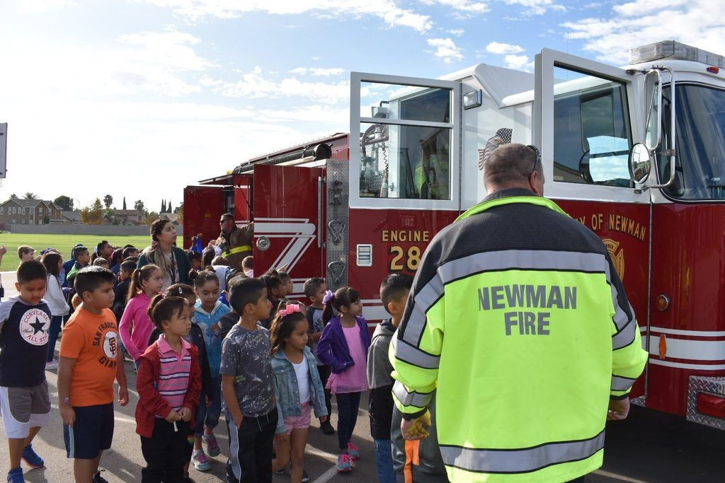 Students learning about the fire truck