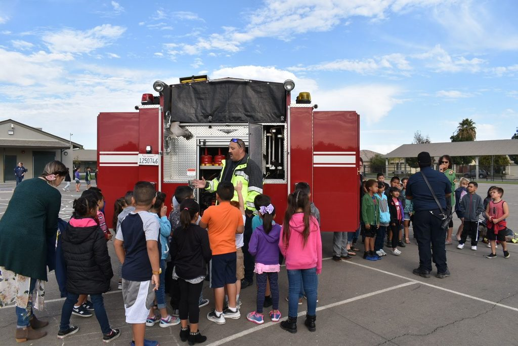 students listening to the fireman