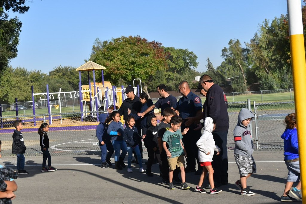 Students meeting firefighters