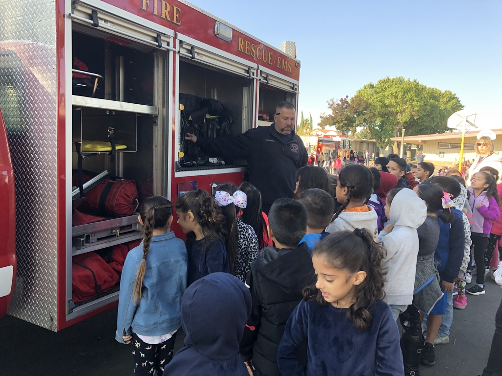 Kids looking in the firefighters' tool truck