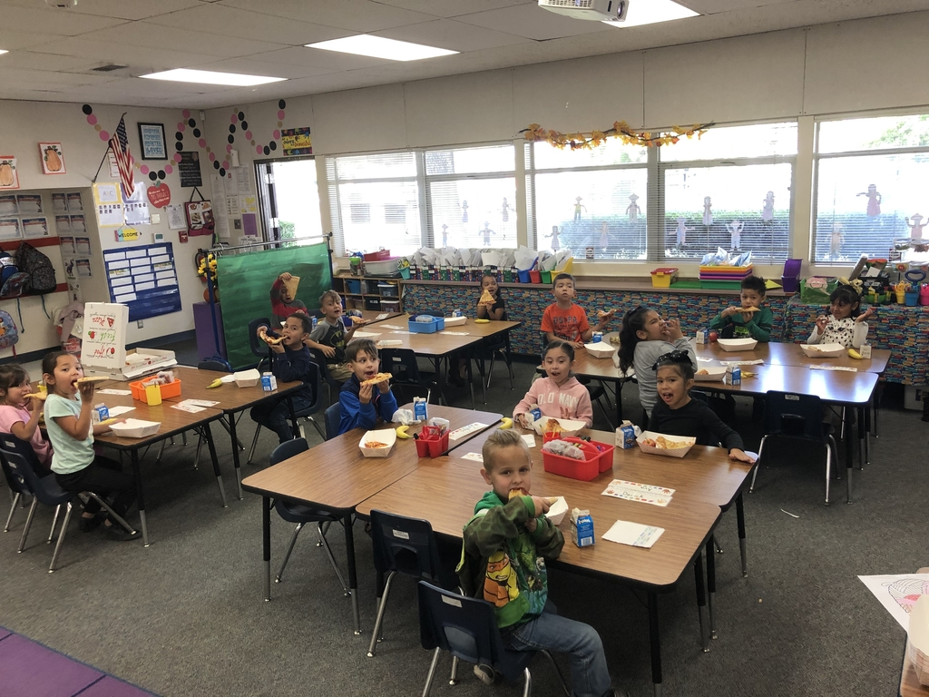 Students enjoying their pizza party
