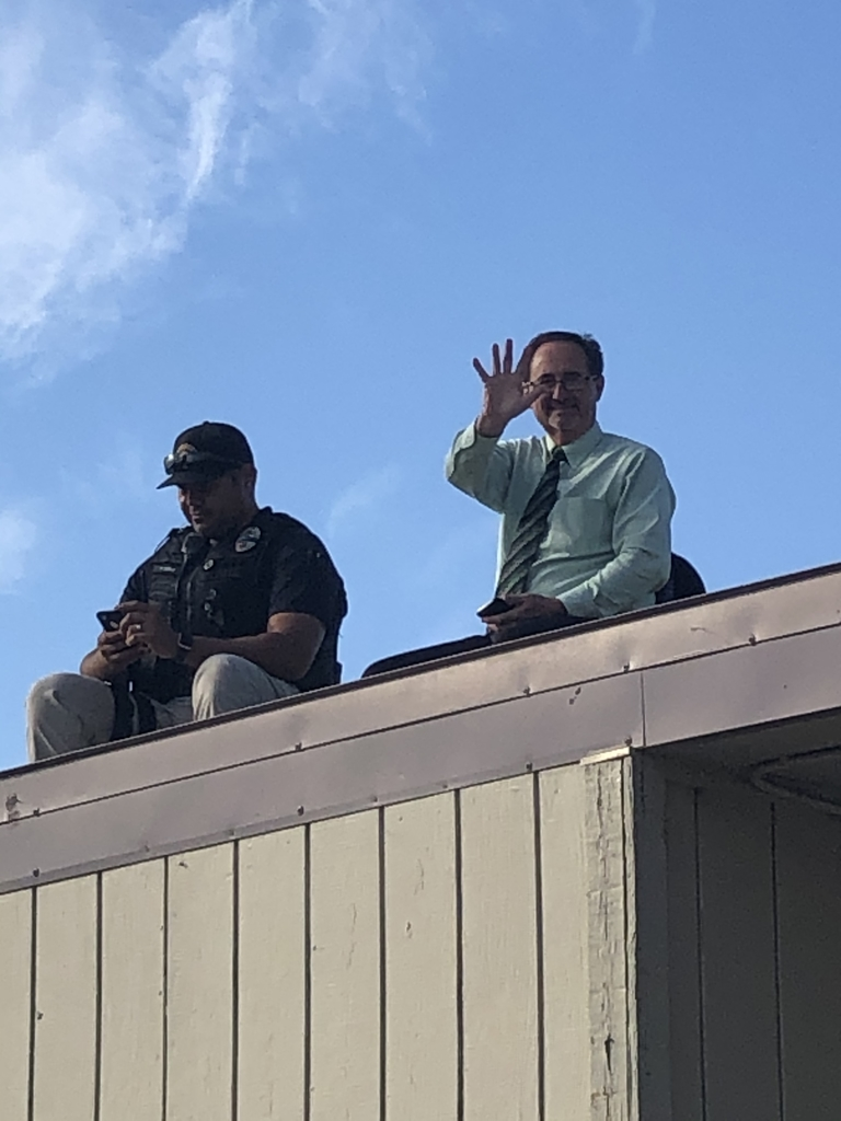 Mr. Cope and Officer Lopez in the roof