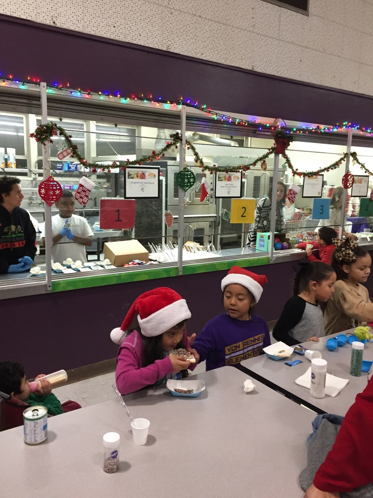 Students eating the cookies they decorated