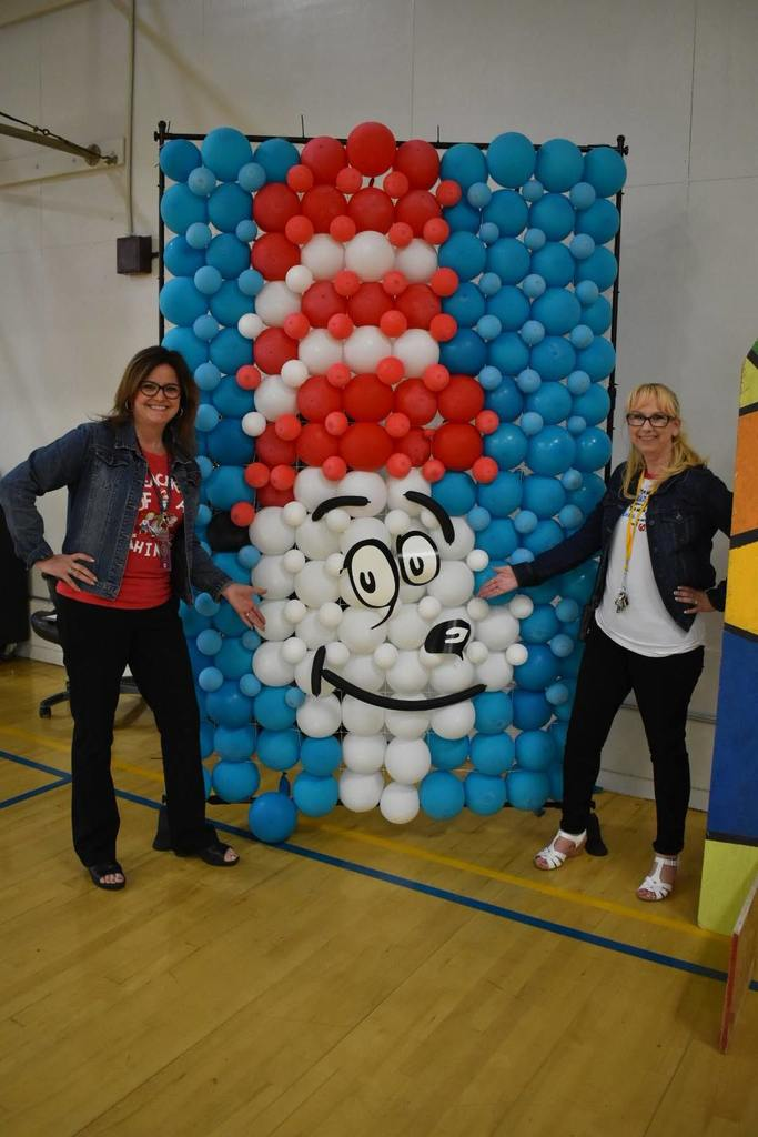 Mrs. Williams and Mrs. Henley posing with the balloon wall