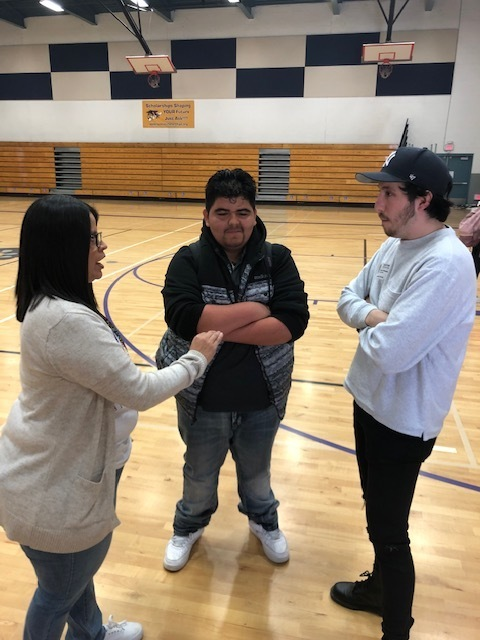 Mrs. Bautista talks to Yolo student Jessie Garza and Adrian about how she has used his videos in class.